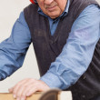 Man Wearing Ear Protectors While Using Table Saw — Stock Photo