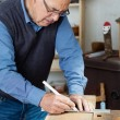 Man Taking Measurement Using Scale On Wood — Stock Photo