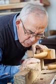 Man Blowing Shavings On Wood — Stock Photo