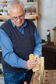 Man Using Planer On Wood At Workshop — Stock Photo