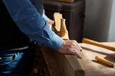 Senior Man Using Planer On Wood At Workbench — Stock Photo