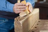Carpenter making something out of wood — Stock Photo