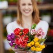Attractive young woman showing a bunch of flowers — Stock Photo
