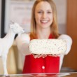 Saleswoman Displaying Goat Cheese In Grocery Store — Stock Photo