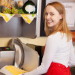 Saleswoman Holding Sliced Cheese While Standing Against Machine — Stock Photo