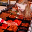 Woman Looking At Sliced Meat On Butcher Hand At Supermarket — Stock Photo