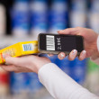 Woman's Hands Scanning Barcode With Mobile Phone In Supermarket — Stock Photo #26944131