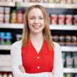 Stock Photo: SaleswomWith Arms Crossed Standing In Grocery Store