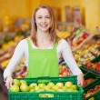 Female Worker Carrying Apple's Crate In Grocery Store — Stock Photo