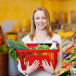 Beautiful Woman Carrying Shopping Basket In Grocery Store — Stock Photo