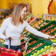 Woman Buying Apples In Grocery Store — Stock Photo #26945431