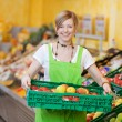 Happy worker in a supermarket — Stock Photo