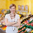 Happy customer standing inside the food department — Stock Photo