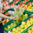 Female customer picking green apples to buy — Stock Photo