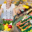 Shopping trolley full of fresh produce — Stock Photo