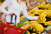 Woman Choosing Bananas In Grocery Store — Stock Photo