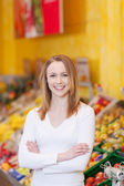 Female Customer With Arms Crossed Standing In Grocery Store — Stock Photo