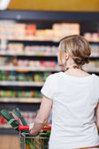 Woman With Shopping Cart At Supermarket — Stock Photo