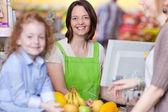Confident Female Cashier Smiling At Supermarket — Stock Photo