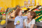 Mother and daughter in the food department — Stock Photo