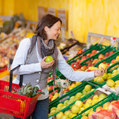 Woman Choosing Apples In Grocery Store — Stock Photo