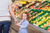 Cute little girl roaming in the supermarket — Stock Photo