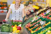 Shopping trolley full of fresh produce — Stock Photo