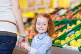 Mother and daughter shopping for fresh fruit — Stock Photo