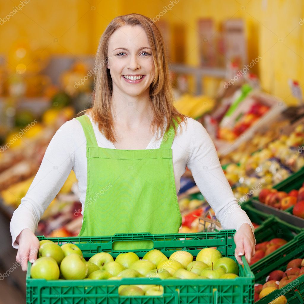 female worker carrying apple s crate in grocery store stock female worker carrying apple s crate in grocery store stock photo 26944733