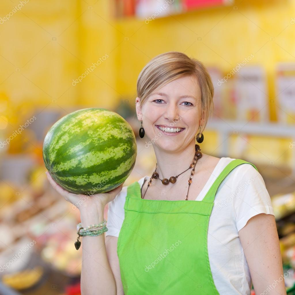 female worker holding watermelon in grocery store stock photo female worker holding watermelon in grocery store stock photo 26946911