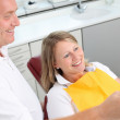 Dentist And Female Patient Analyzing Xray — Stock Photo
