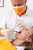 Dentist Wearing Mask Injecting Woman's Mouth — Foto de Stock