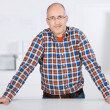 Portrait of a friendly mature man on the office — Stock Photo