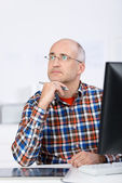 Serious and pensive mature man looking up and away — Stock Photo