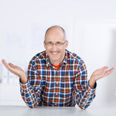 Smiling mature man raising his hand in the air — Stock Photo