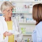 Pharmacist Giving Prescribed Medicine To Customer In Pharmacy — Stock Photo