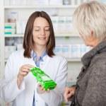 Pharmacist Explaining Product Details To Customer — Stock Photo #26987067