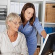 Two generations working together — Stock Photo