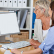 Two females looking at the computer — Stock Photo