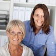 Young and old generation posing in office — Stock Photo #26988183