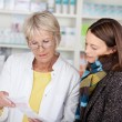 Pharmacist explaining the prescription — Stock Photo