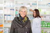 Senior with a scarf in the pharmacy — Stock Photo