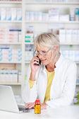 Pharmacist having a call — Stock Photo