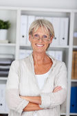 Senior woman with crossed arms — Stock Photo