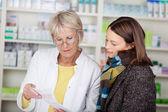 Pharmacist explaining the prescription — Stock Photo