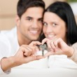 Happy young couple holding their new house key — Stock Photo