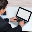 Young Businessman Using Laptop At Desk — Stock Photo