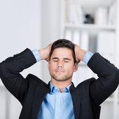 Young businessman with hands on his head — Stock Photo