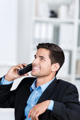 Businessman Using Cordless Phone While Looking Up — Stock Photo