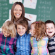 Teacher and young students — Stock Photo #27047207